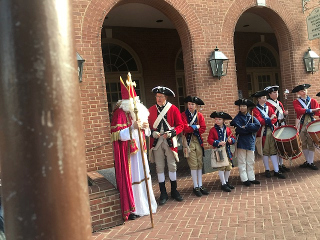 St. Nick with fife and drum corp
